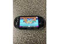128GB ps vita oled console with 15,000 games
