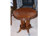 "Round wooden table (24""x 21 1/2"")"