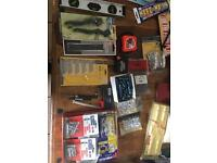 Lots of different tools devices, raw plugs, anchors hacksaw blades