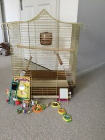 Bird cage hardly used . Toys included.