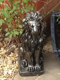 Gorgeous pair of solid sitting bronze effect lions