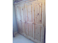 Very large solid pine wardrobe, unpainted. URGENT