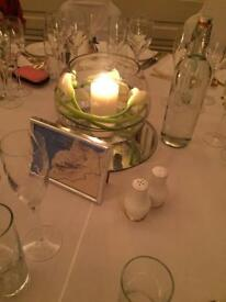 Weddding fish bowls and mirror plates table arrangements settings