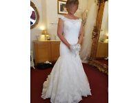 Mori Lee size 10 wedding dress. Never worn for wedding.