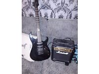 Sx electric guitar with marshall amp
