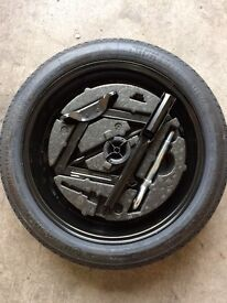 New/unused spare wheel with continental tyre with jack, wheel wrench & storagebox