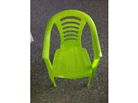 Two Green Plastic Toddler Chairs