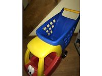 A Little Tikes Cozy Coupe kids shopping trolley, red, yellow and blue, good condition.