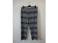 dkny black and white womens trousers size 14 brand new cost £190 when purchased