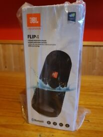 JBL Flip 4 new and boxed ( unopen and sealed) - waterproof and impressive sound.