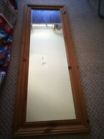 Wooden framed mirror with a hook
