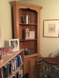 A pretty antique pine corner cupboard