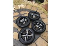 4 15 inch black and silver alutec alloy wheels