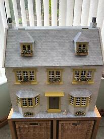 Dolls house for sale with working lights.