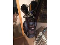 Men's golf clubs with electronic trolley