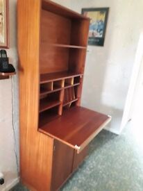 Wooden hand made bureau. Used as a photo albums and games cupboard