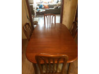 Large teak g-plan style dining room table and 4 chairs for sale