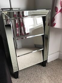 Mirrored glass bedside tables and chest of drawers