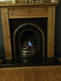 Living flame gas fire with back & wooden surround