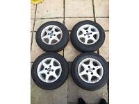 4 Car tyres on alloys nearly new