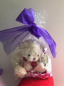 Three individually gift wrapped teddies