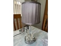 Chrome table lamp with grey pleated shade