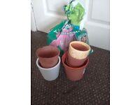 Half bag of potting compost and vaious pots.