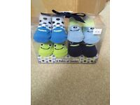 Brand new Cutie Pie monster socks 0-12 months
