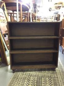 Antique oak bookcase on bun feet.