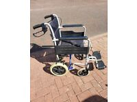 Very Lightweight Folding Transit Wheelchair. Only weighs 11.5 kg. 18 inch seat