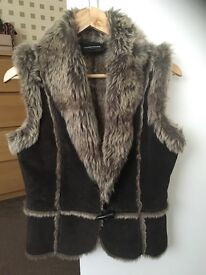Warehouse fur lined body warmer. Size 12