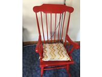 Solid pine sturdy red rocking chair.