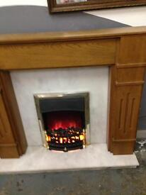 Solid wooden and solid white marble fire surround with electric fire
