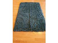 Teal blue rug approx 5.5ft x 4ft
