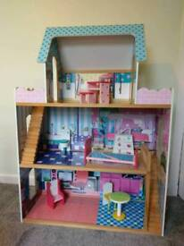 4ft dolls house and 13 various Barbie dolls including furniture and accessories and clothes
