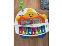 Fisher Price interactive baby grand piano
