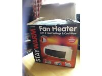 FAN HEATER WITH 2 HEAT SETTINGS AND COOL BLOW