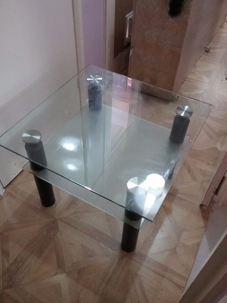 Glass table with shelf under