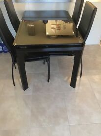 BLACK GLASS EXTENDABLE TABLE & 4 CHAIRS