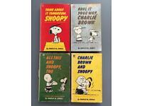 Four Charlie Brown Cartoon Books