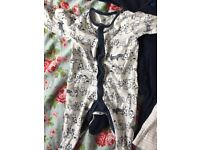 Three 0/3 baby grows. 2 from next & 1 from Asda.