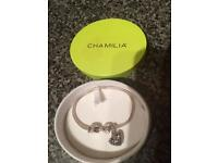 Chamilia Braclet with two charms.