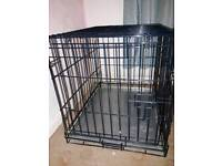 Dog crate with puppy pads