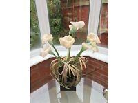 Silicon white calla lily in black vase