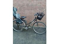 """Girls 26"""" bike with baby carrier"""