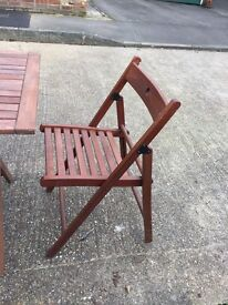 Real wood indoor or outdoor folding table and chairs, great condition.