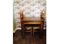 Solid wood kitchen table and two matching chairs