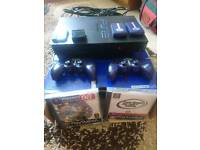 PlayStation 2 with wireless controllers