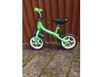 Boys green balance bike