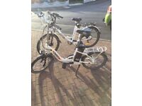 2 electric throttle bikes. Excellent condition. ladies is a fold up bike. Rarely used